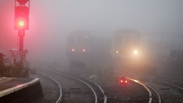 Trains travelling through thick fog