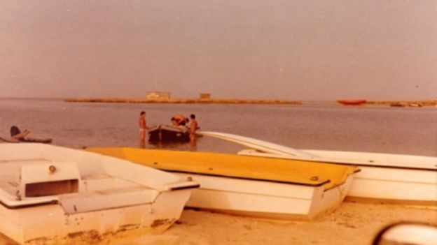 Boats at Arous village, with Mossad agents in the background