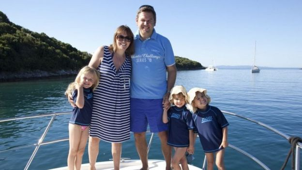 Karen Beddow with her family on a yacht