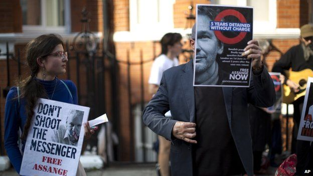 Julian Assange supporters outside the Ecuadorian embassy