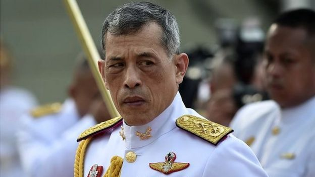 Thailand's King Vajiralongkorn is seen paying respects at the statue of King Rama I after signing the military-backed constitution in Bangkok on April 6, 2017.