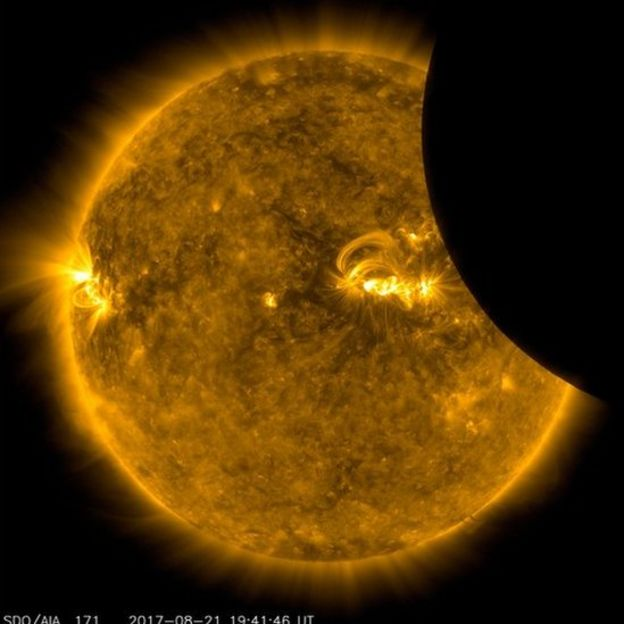 Image of the Moon transiting across the Sun, taken by SDO in 171 angstrom extreme ultraviolet light on Aug. 21, 2017.