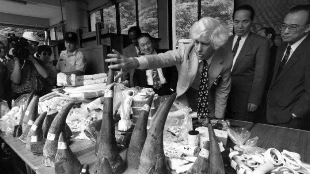 Esmond Martin (3rd R), a United Nations special envoy whose responsibility is the problem of rhinoceros poaching and trafficking, inspects 20 confiscated rhino horns, elephant tusks and ivory objects at the Taipei Zoo 04 June before the illegal goods were incinerated publicly to demonstrate the government's commitment to protecting wildlife.