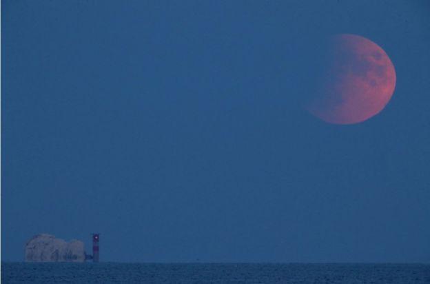 Apollo 11: Partial lunar eclipse on 50th anniversary - BBC News