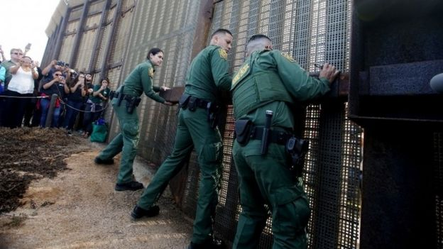 Guards open the door at the border