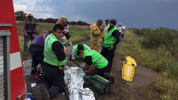Authorities treat the injured at the scene of the Durango plane crash