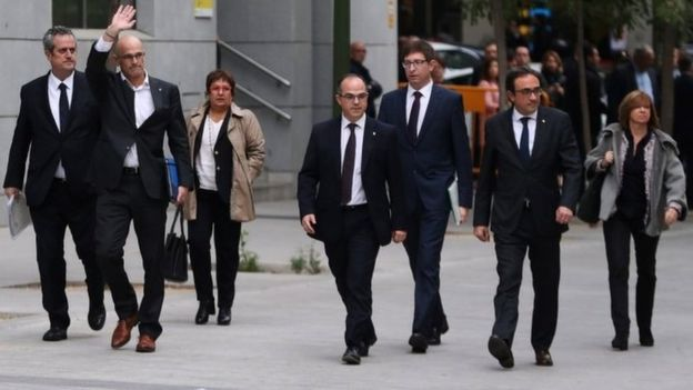 Dismissed Catalan cabinet members (L-R): Interior Minister Joaquim Forn, Foreign Affairs Minister Raul Romeva, Labour Minister Dolors Bassa, Government Presidency Councillor Jordi Turull, Justice Minister Carles Mundo, Sustainable Development Minister Josep Rull and Culture Minister Meritxell Borras arrive at Spain's High Court