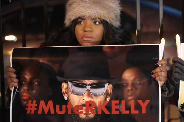 A protester calls for Spotify and radio stations to mute R Kelly