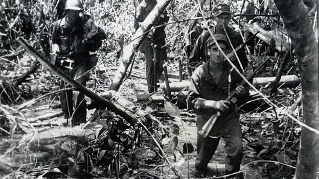US troops advance against Japanese forces during World War Two