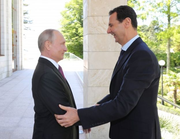 Vladimir Putin greets Bashar al Asad