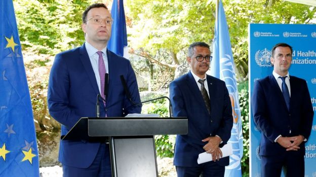 German Health Minister Jens Spahn speaks to reporters, with WHO Director General Tedros Adhanom Ghebreyesus and French Health Minister Olivier Veran in Geneva, Switzerland (25 June 2020)