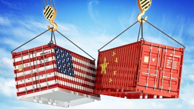 Shipping containers with US and Chinese flags