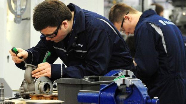 Boys assemble engine parts