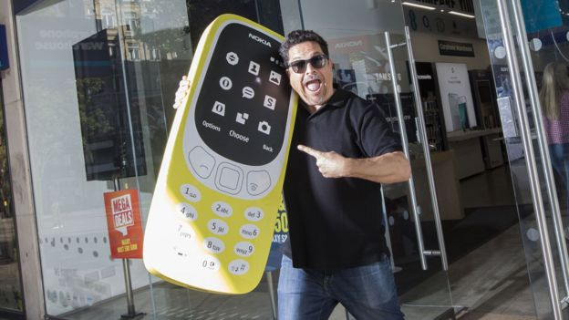 Dom Joly with a giant Nokia 3310