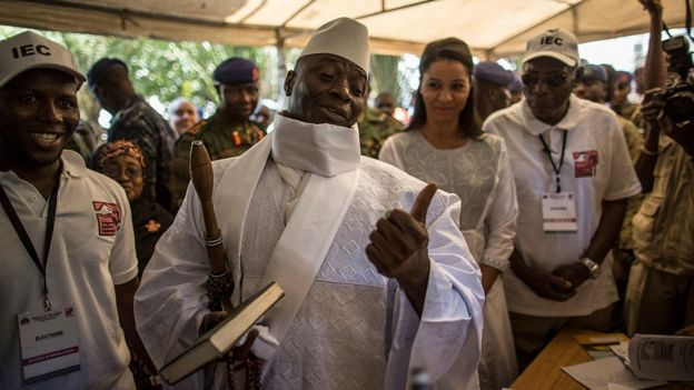 Yahya Jammeh showing his ink-printed thumb as evidence he voted