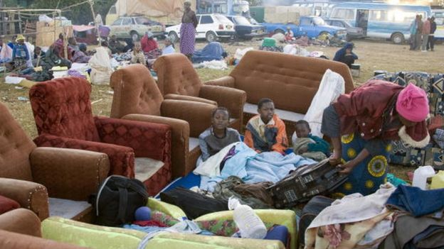 People, fleeing the wave of violence that has left at least 360 people dead and displaced 250,000 following the presidential elections, sit next to their belongings at Langata police station where Internally Displaced People (IDP's) seek refuge outside El Doret, western Kenya, 05 January 2008