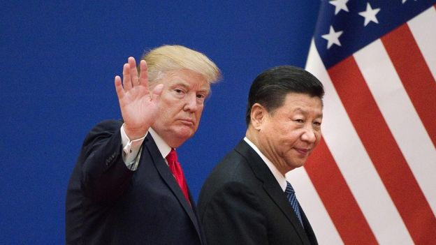 "In this file photo taken on November 9, 2017 shows US President Donald Trump (L) and China""s President Xi Jinping leaving a business leaders event at the Great Hall of the People in Beijing."