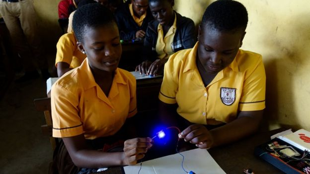 Princess Makafui and her friend use the science kit