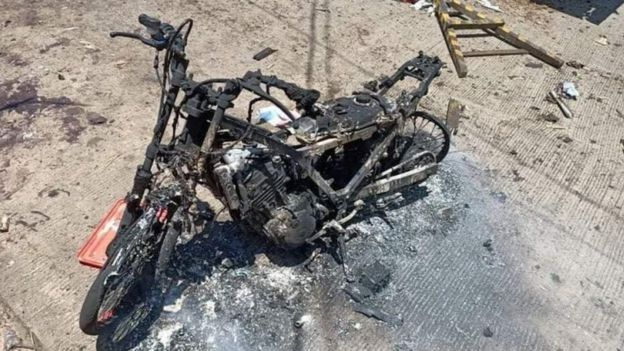 Burned motorcycle is pictured in the aftermath of an explosion in Jolo Island, Sulu province, Philippines