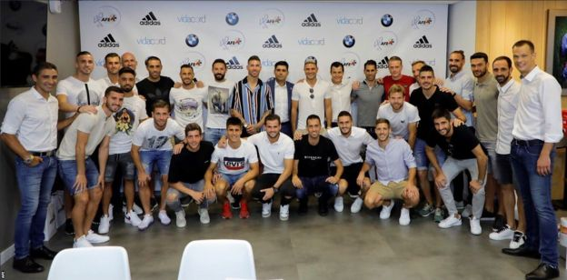 La Liga players pose for a photograph after their AFE meeting