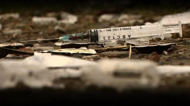 Syringe on floor