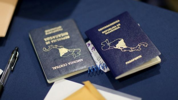 Two blue Nicaraguan passports on a table