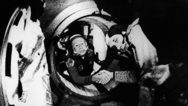 Commander of the Soviet crew of Soyuz, Alexei Leonov (L) and commander of the US crew of Apollo, Thomas Stafford (R), shake hands after the Apollo-Soyuz docking manoeuvres on 17 July 1975