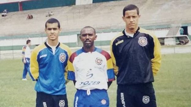 Douglas Braga (left) with the coach of Madureira and a teammate