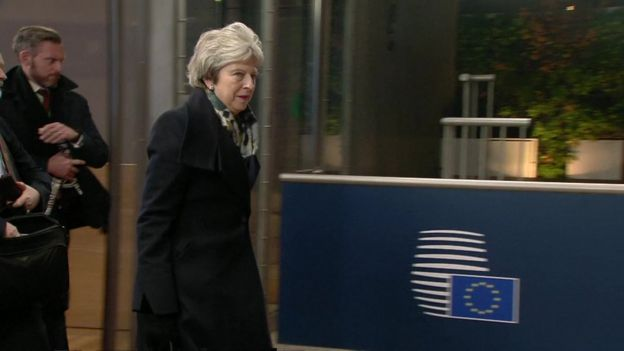 Theresa May leaves the summit