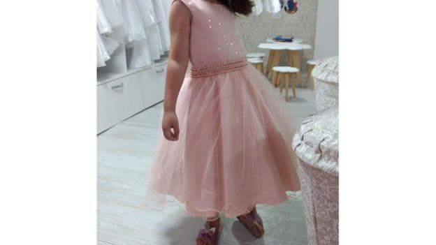 Luiz con un vestido