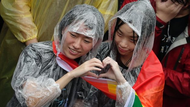 Supporters of same-sex marriage gather outside the parliament building as a bill for marriage equality is debated by parliamentarians in Taipei, Taiwan, 17 May 2019