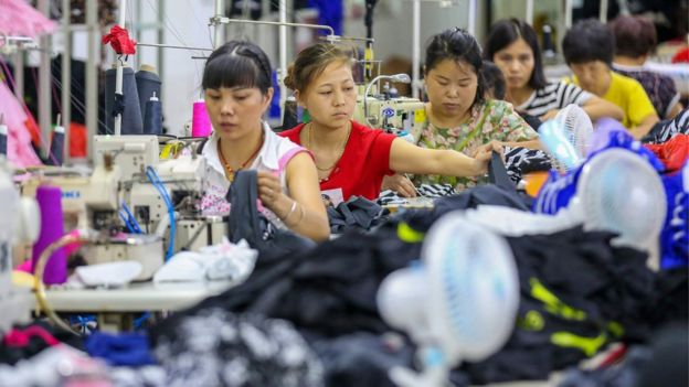 This photo taken on August 2, 2018 shows workers at a swimwear factory in Yinglin town in Jinjiang, in China's eastern Fujian Province.
