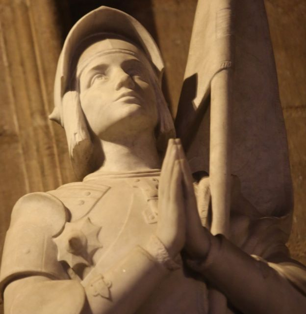 A statue of St Joan of Arc inside Notre-Dame