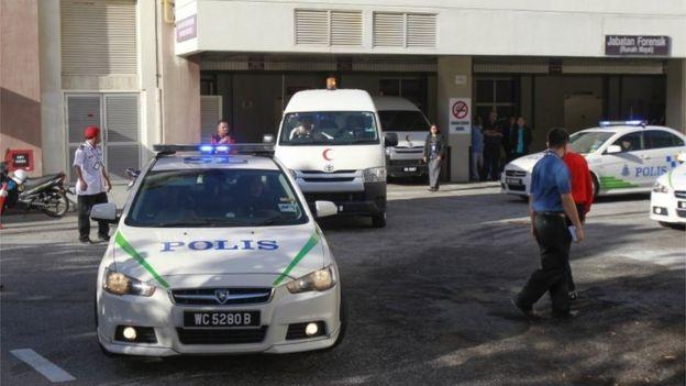 Police van escorts a hospital van leaving Putrajaya hospital, Malaysia (15 Feb 2017)