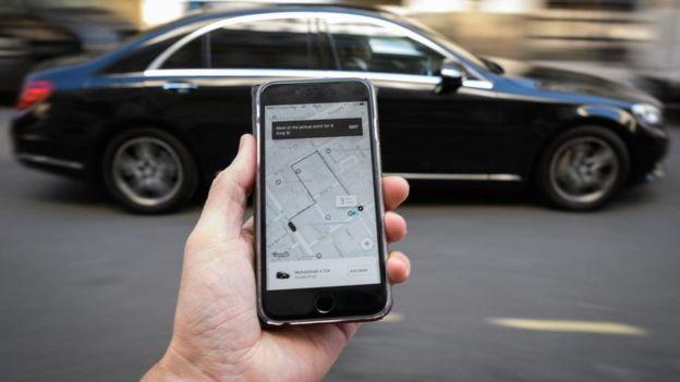 Man using Uber app