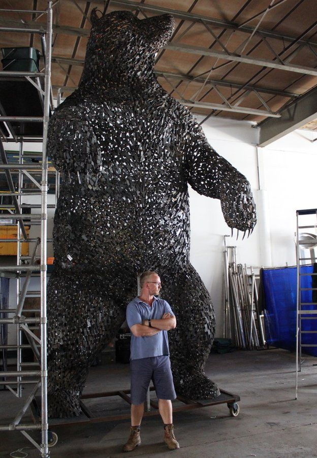 Andy Scott standing in front of bear sculpture