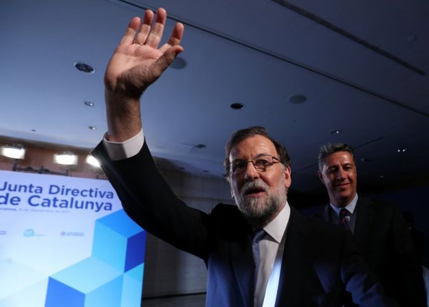 Spanish Prime Minister Mariano Rajoy waves at his arrival to a Catalan regional Popular Party meeting in Barcelona, Spain, 15 September