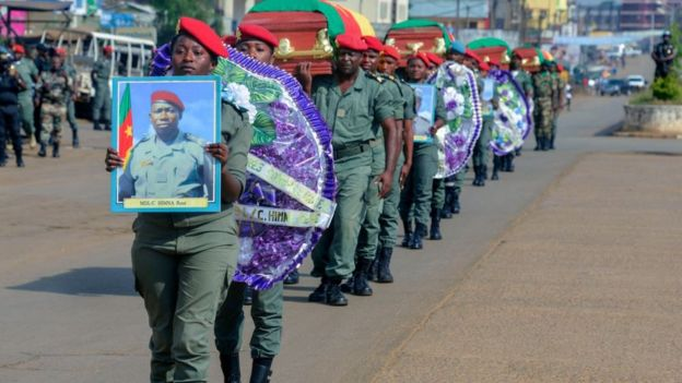Soldiers carry the coffins of the four soldiers killed in the violence that erupted in the Northwest and Southwest Regions of Cameroon, where most of the country's English-speaking minority live, during a ceremony in Bamenda on November 17, 2017