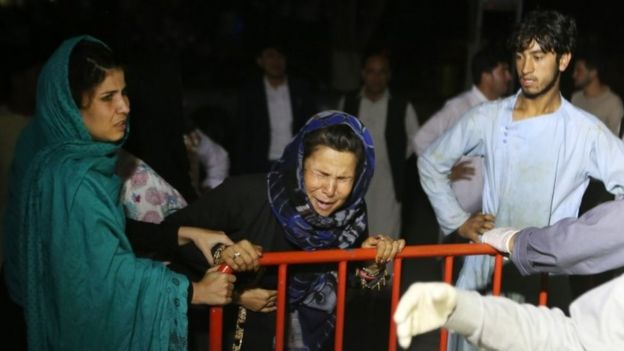 A woman cries outside a hospital after the blast