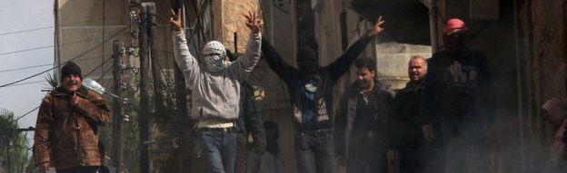 Anti-government protesters on the streets of the Syrian city of Deraa on 23 March 2011