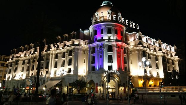 The Promenade des Anglais in Nice shows the Negresco hotel illuminated in the colours of France's flag in tribute to the victims of the Bastille Day attack, 17 July 2016