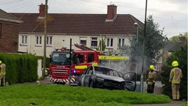Car burnt out next to fire engine