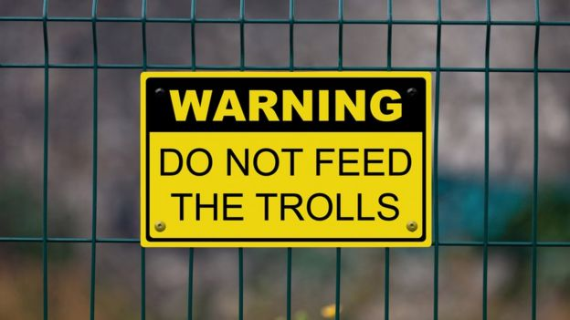 "A sign warning to ""not feed the trolls"""
