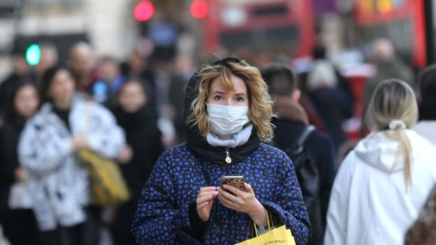 A woman in London wearing mask