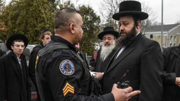 Men outside rabbi's house