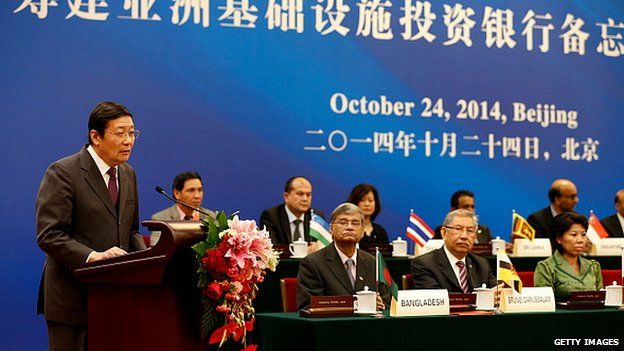 Chinese Finance Minister Lou Jiwei (L) speaks during the signing ceremony of the Asian Infrastructure Investment Bank on 24 Oct, 2014 in Beijing, China