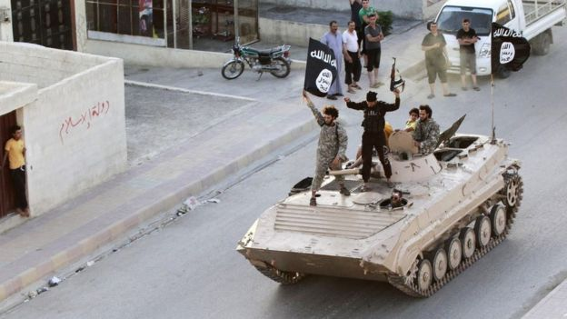 Fighters from Islamic State of Iraq and the Levant (Isil/Isis) take part in a military parade in Raqqa on 30 June 2014