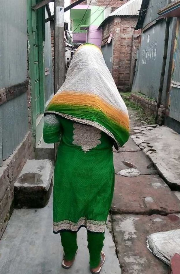 A sex worker in the alleyways of Bangladesh's Daulatdia brothel.