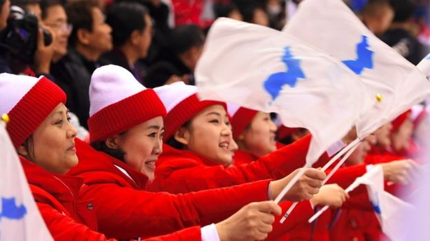 """Cheerleaders from North Korea hold the flag of """"Unified Korea"""" during the PyeongChang Games."""
