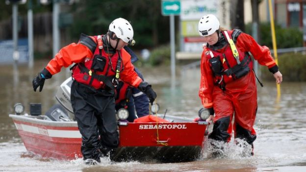 rescue crews drag a boat in the water